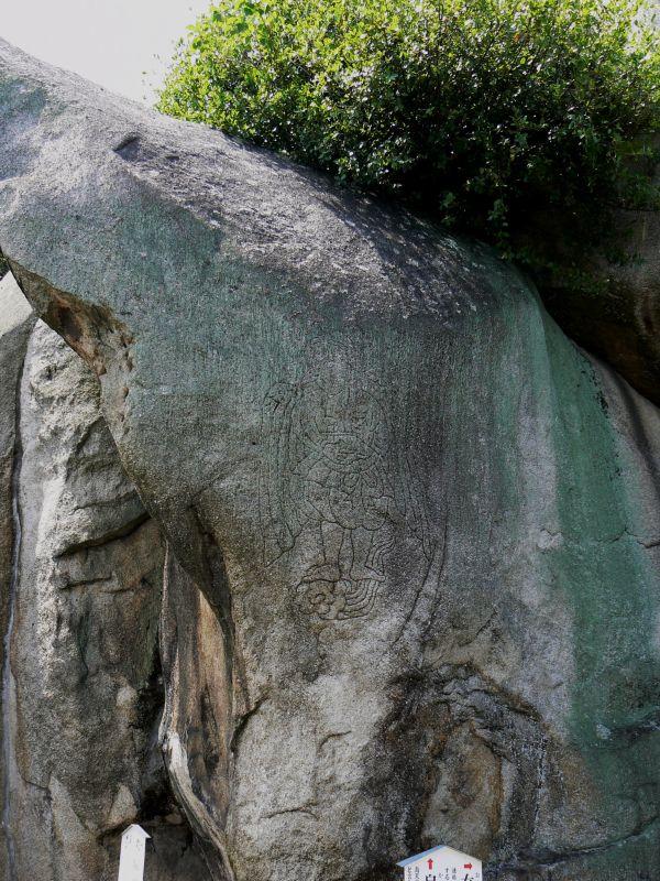 Worn rock carving