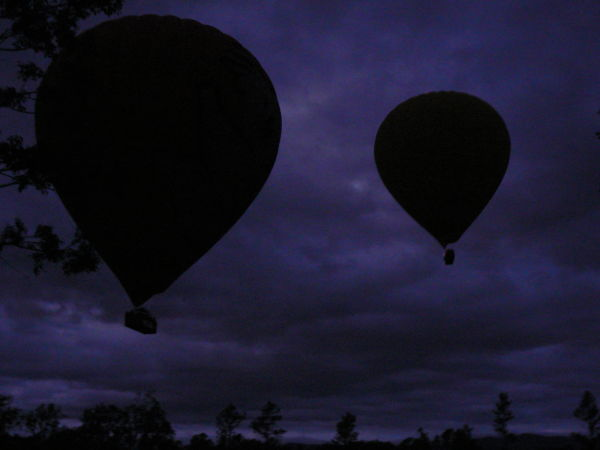 Hot air balloons silhouetted against the sky