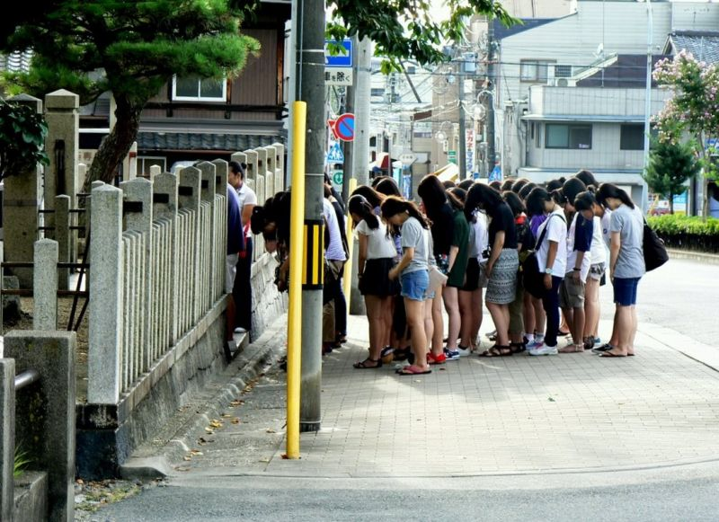"""Korean tourists paying respect at the """"Ear Mound"""""""