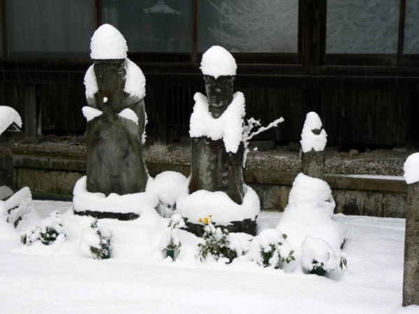 Japanese statues in the snow