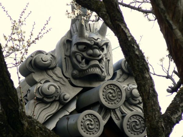 Japanese tiled roof with oni (devil)