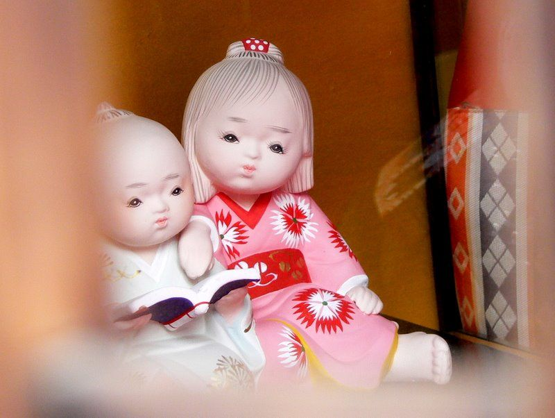 Two child dolls in a Doll Festival display