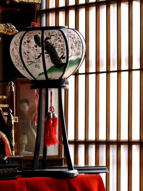 Japanese ornamental lantern standing near a window