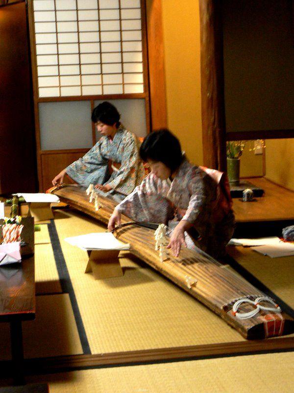 Two Japanese women playing koto music