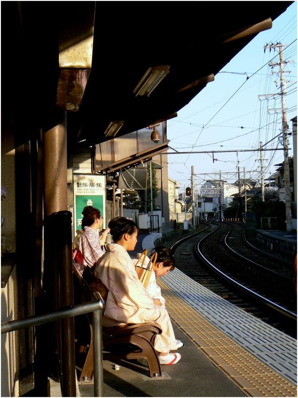 Kimono ladies waiting for the train