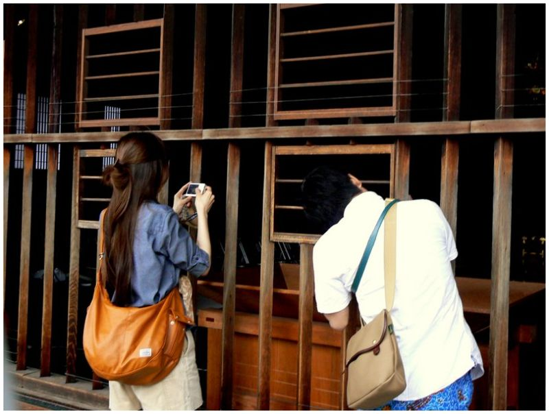 Sightseers taking photos at Japanese temple