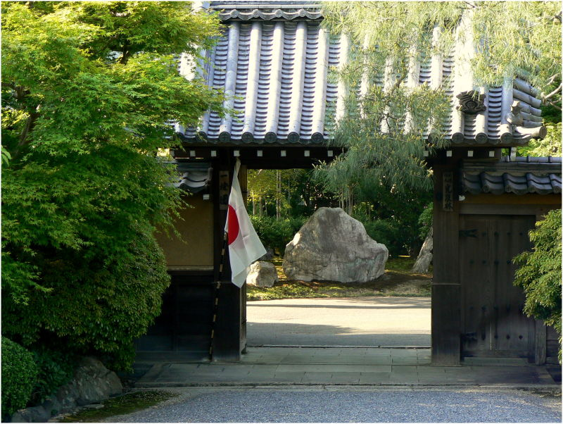 Rock garden glimpsed through a Japanese gate