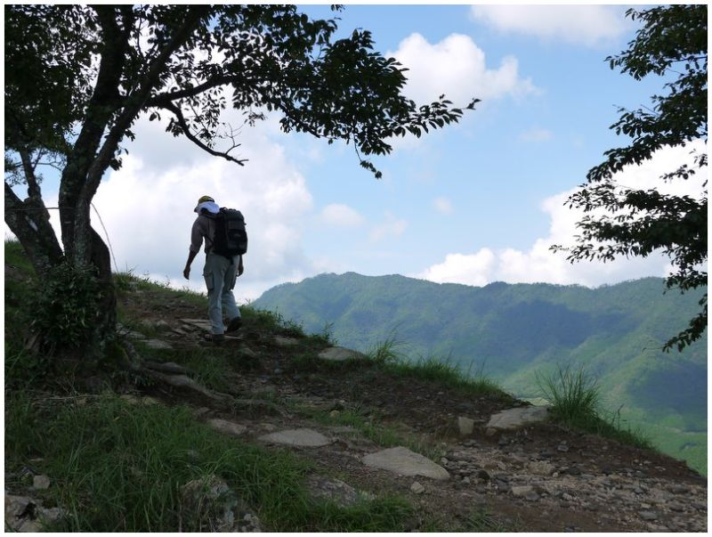 Hiker on path at Takeda Castle ruins