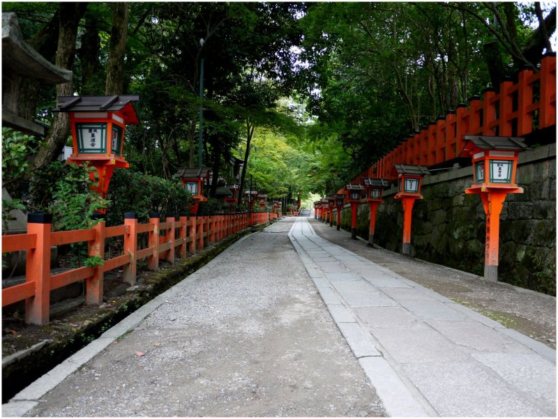 Road with red wooden lanterns
