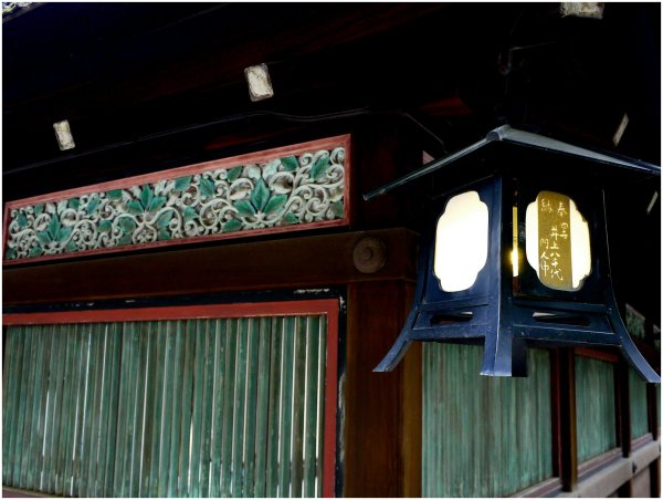 Carved wood and lantern at a shrine in Kyoto
