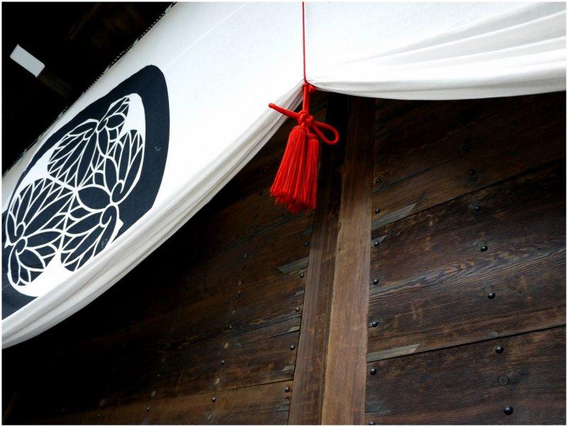 Red tassel on door curtain