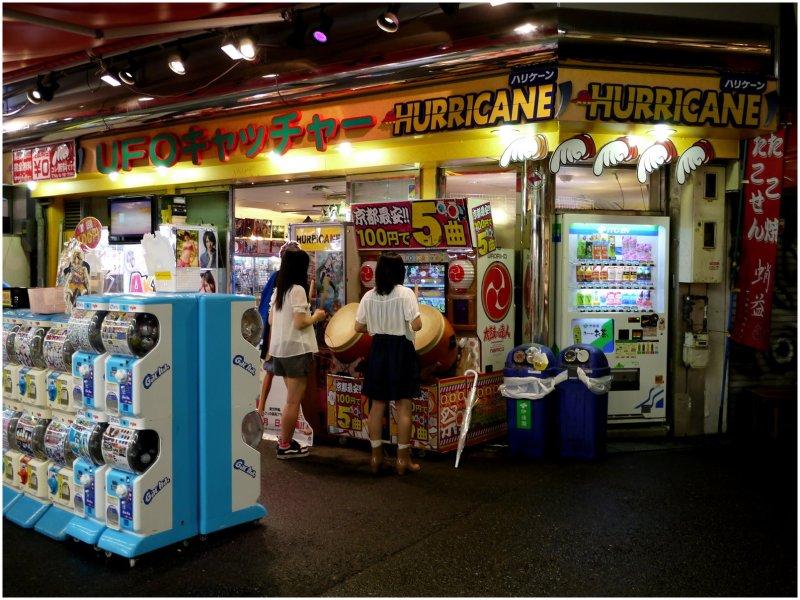 Schoolgirls playing at an amusement arcade