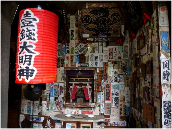 Small sticker covered shrine in Gion, Kyoto