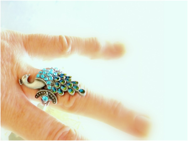 Peacock ring with blue stones