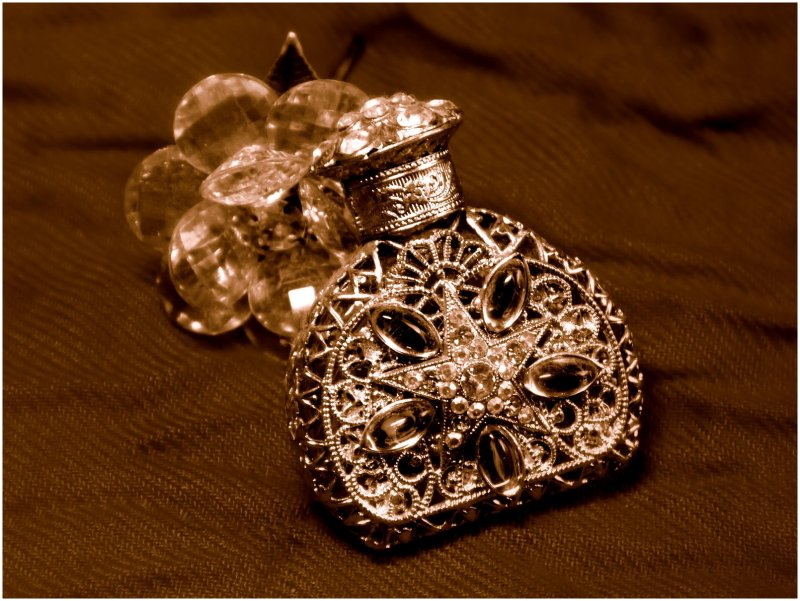 Crystal rose & perfume bottle in sepia