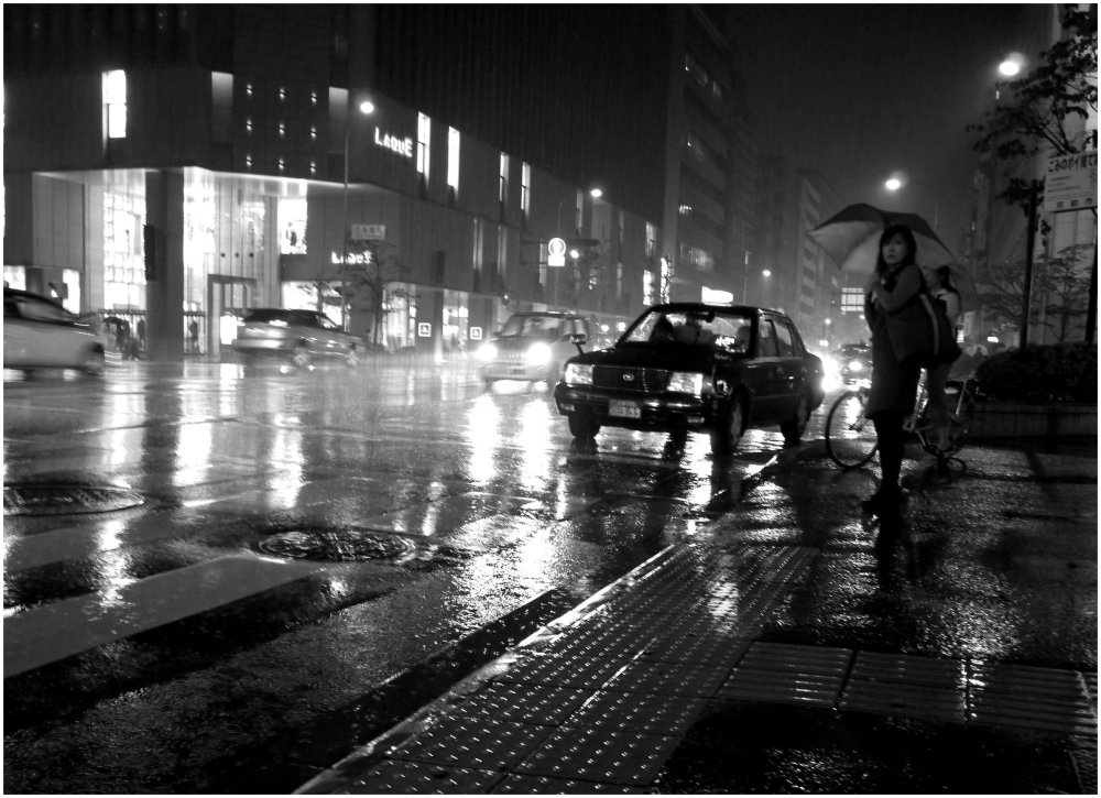 Woman with umbrella  on rainy night