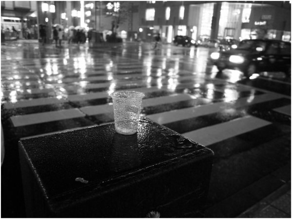 Plastic cup in the rain