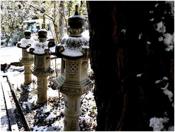Japanese stone lanterns in snow