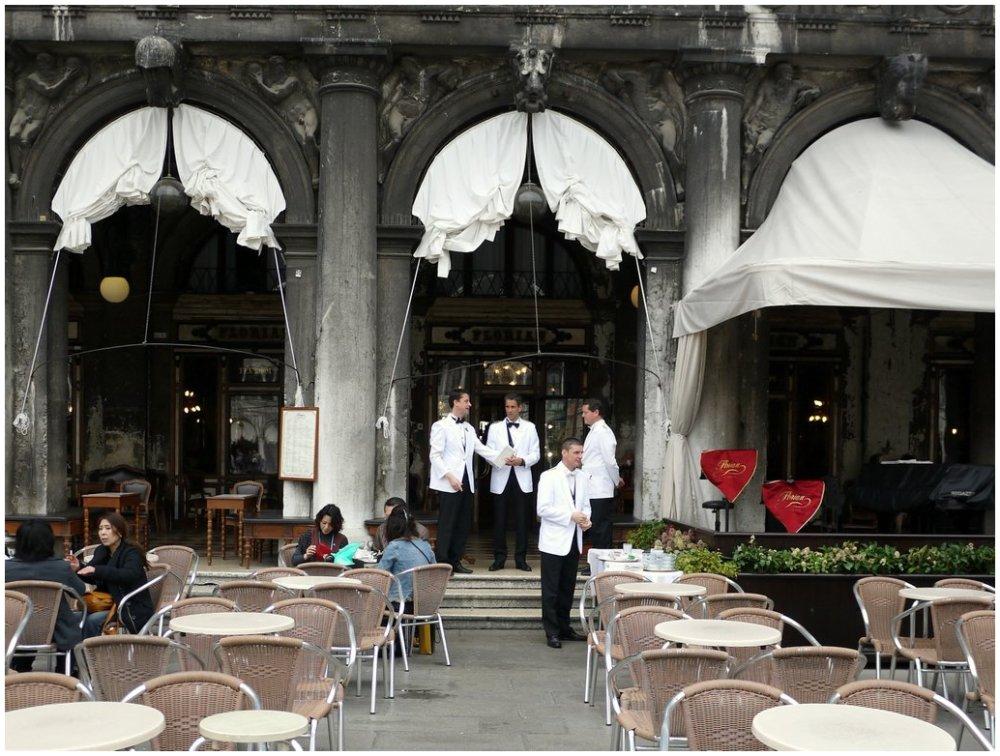 Italian waiters outside restaurant