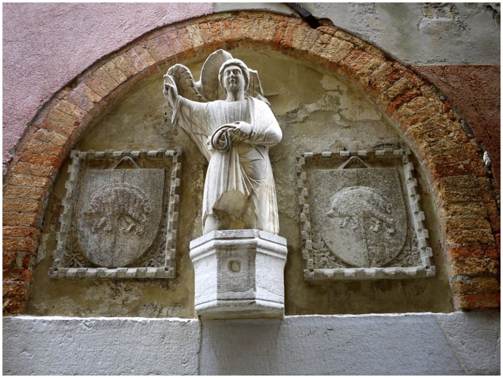 Statue of angel with hedgehogs
