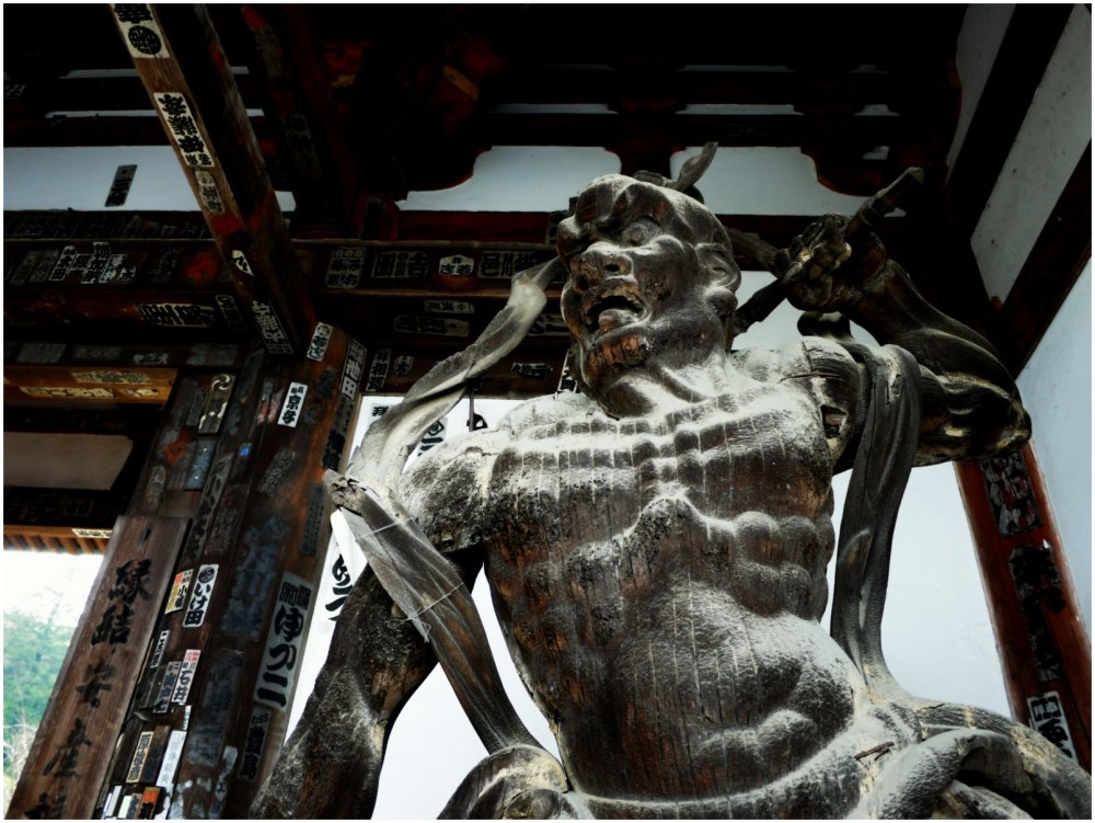 Guardian statue at temple gate