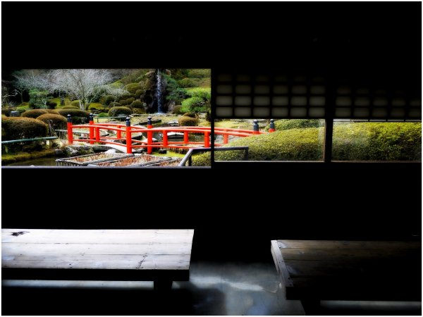 Window framed view of Japanese bridge