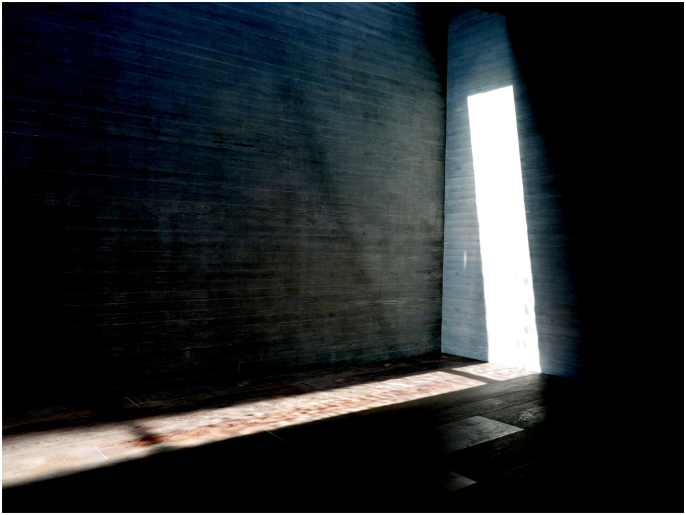 Narrow window admits a shaft of light