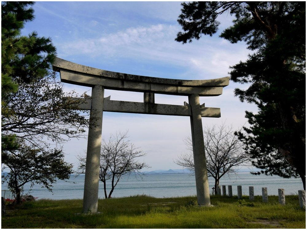 Stone torii beside lake