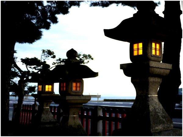 Japanese stone lanterns at dusk