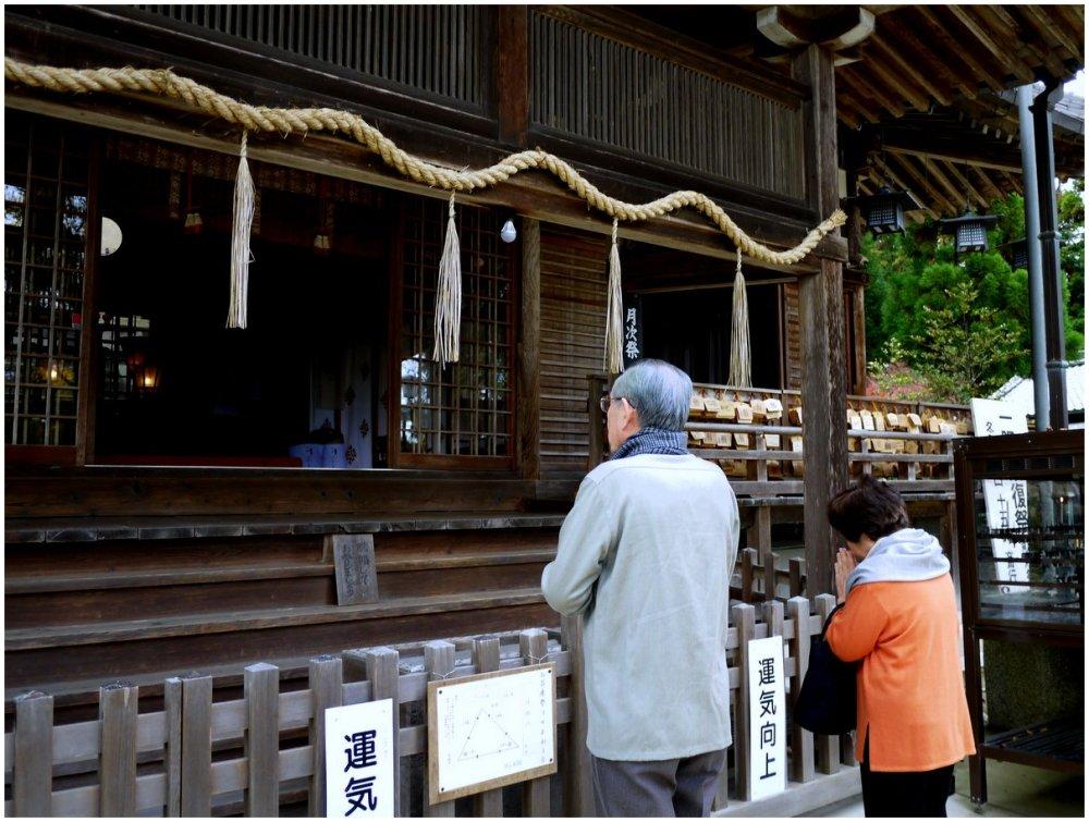 People praying at a Japanese shrine