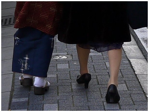 Women's feet wearing shoes and Japanese geta