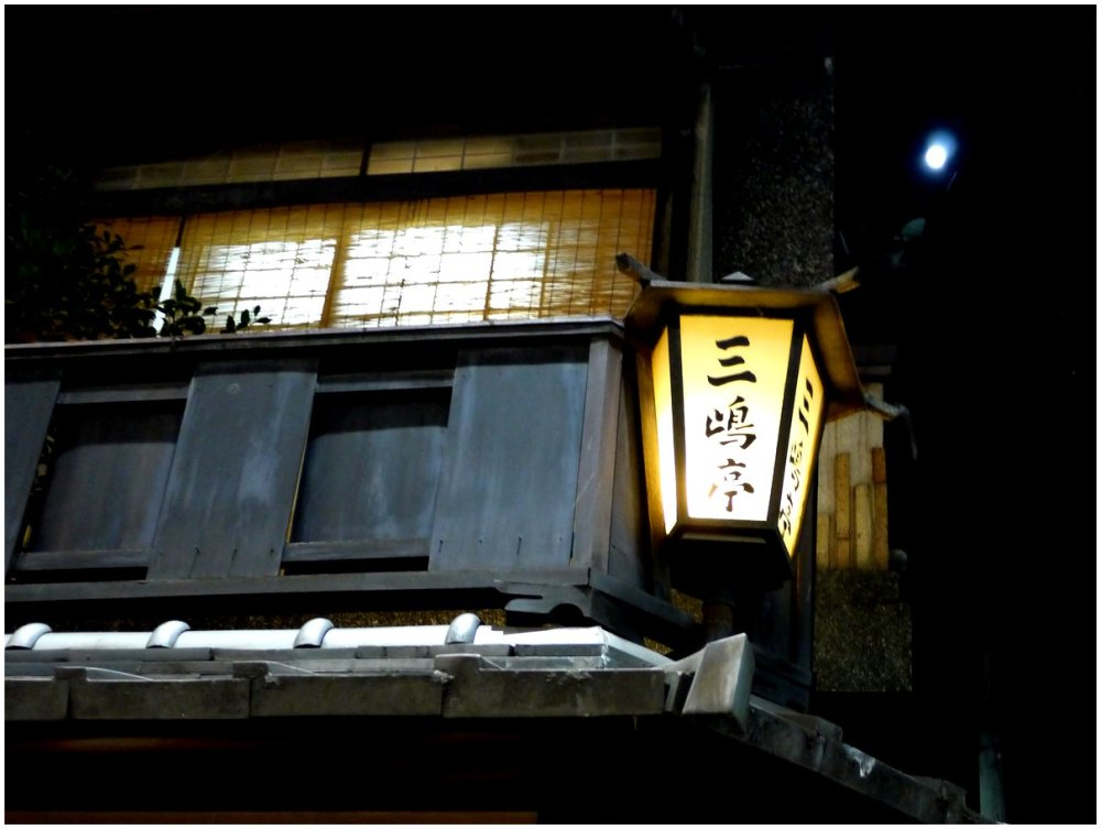 Moon above a traditional Japanese house