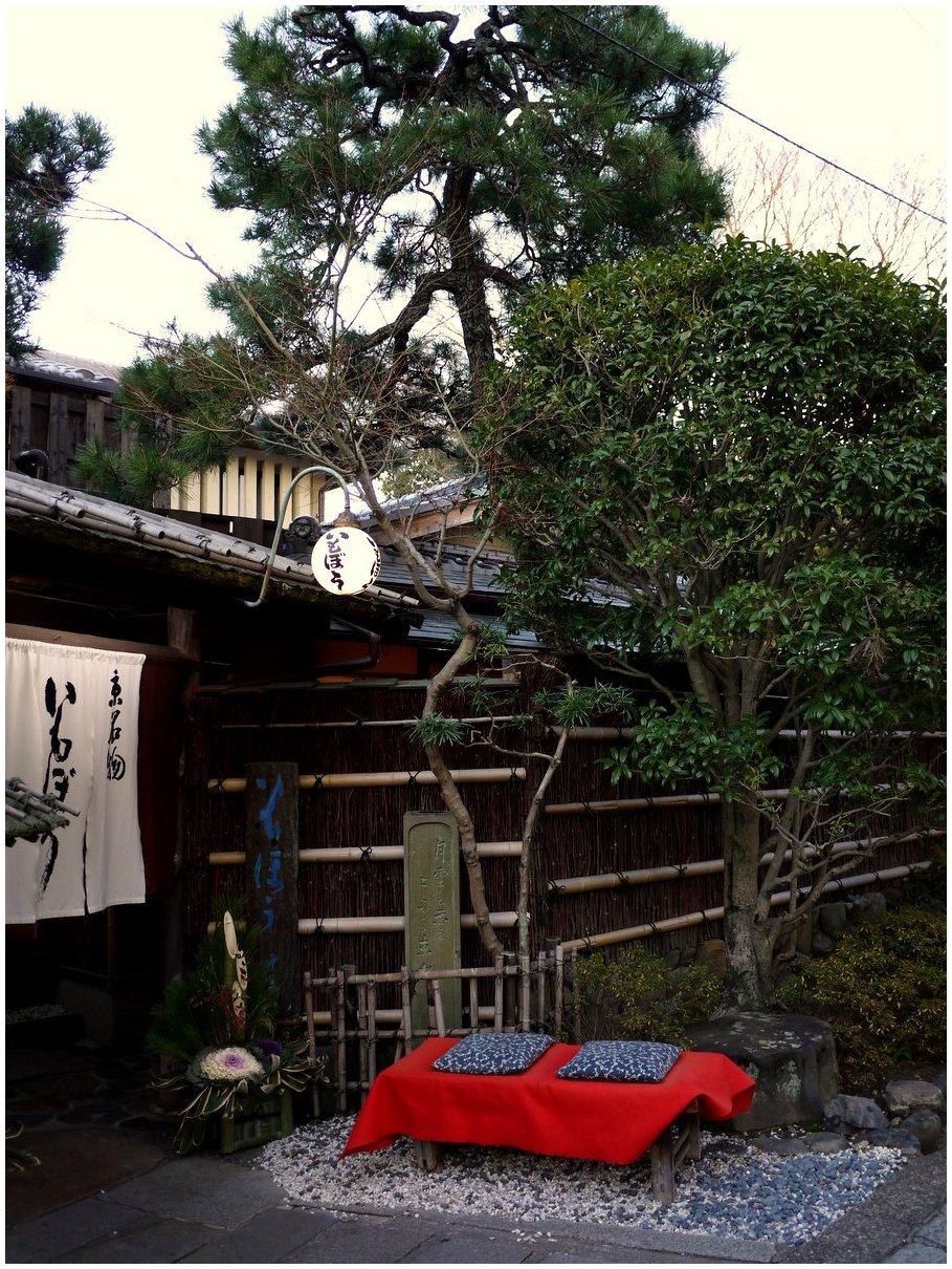 Red bench outside Japanese restaurant