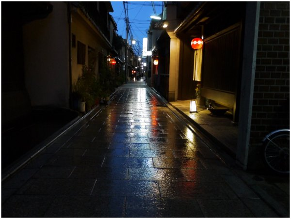 Paved street in Kyoto at night