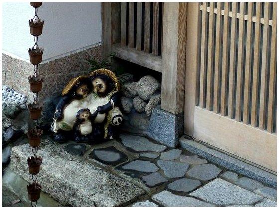 Tanuki family ornament in doorway