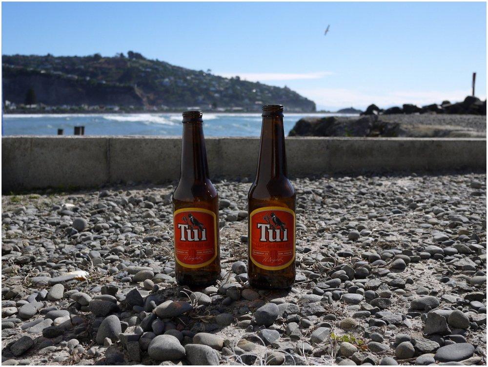 Empty beer bottles at beach