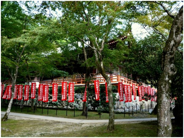 Japanese temple surrounded by red banners