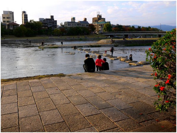 People beside river at Demachiyanagi in Kyoto