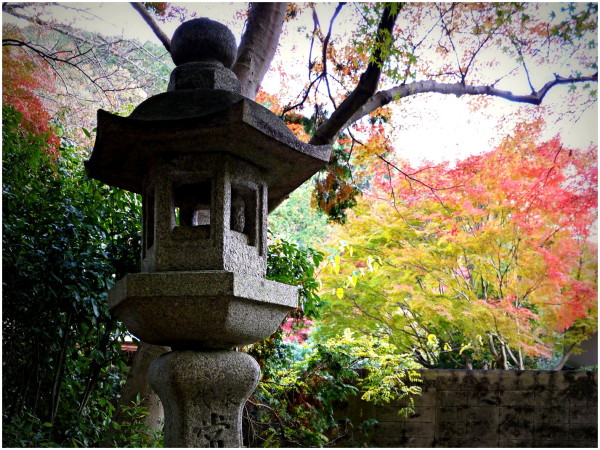 Japanese stone lantern in autumn