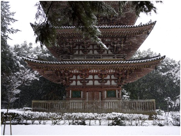 Wooden Japanese pagoda in snow