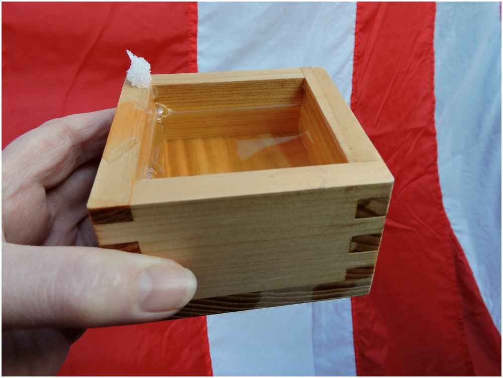 Japanese sake in wooden cup with salt on the side