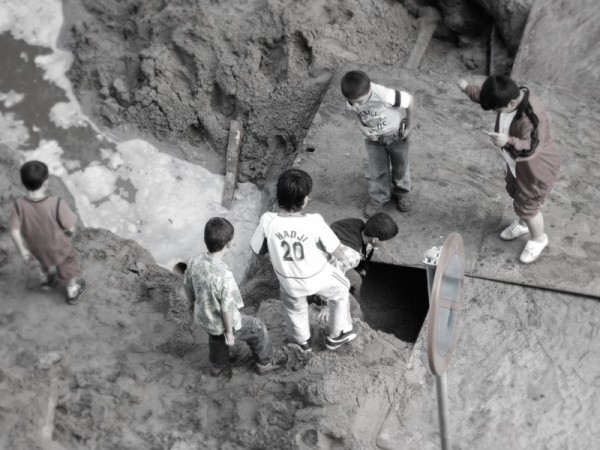 Children playing at a construction area