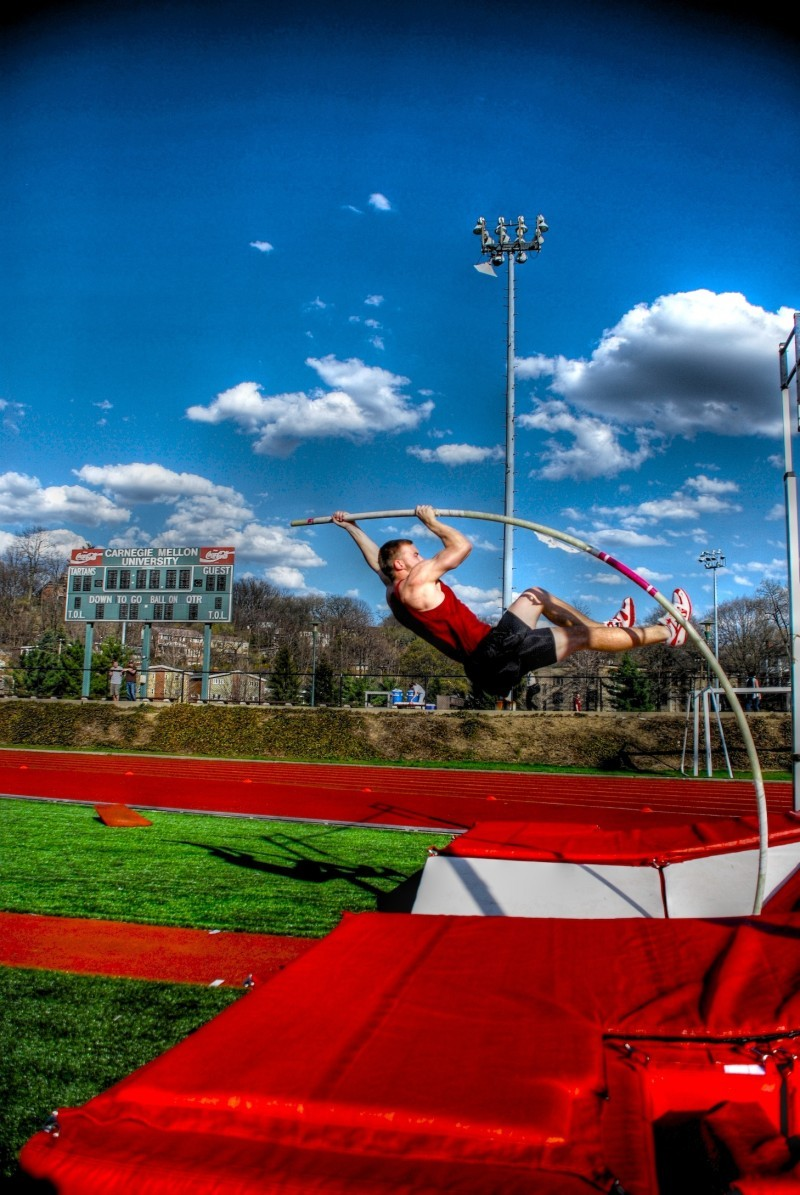 CMU Pole-Vaulter competes in track meet.