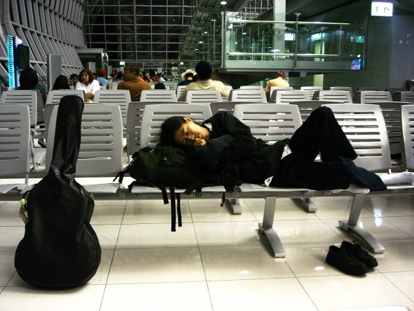 a guitarist taking a nap for boarding