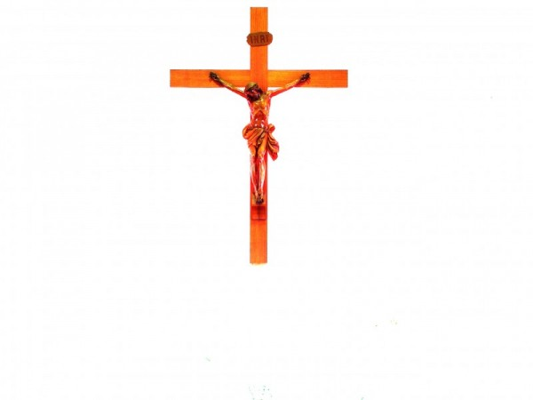 a cross hanging in a catholic church