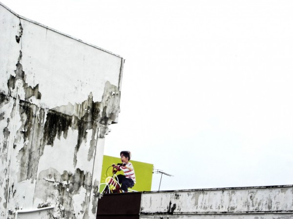 an advertisement boy cycling on rooftop dangerous