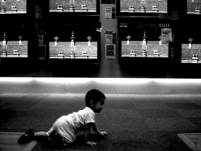 a baby crawling on the floor tv sets sales market