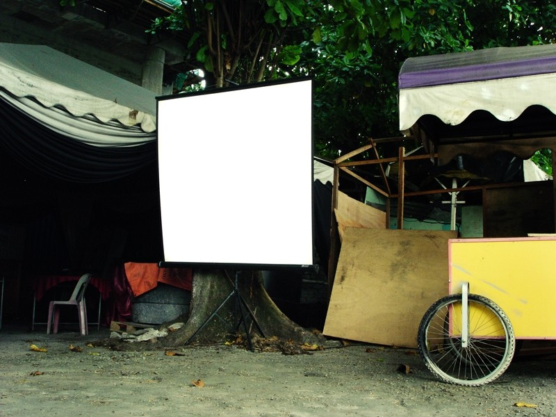 a white screen for projection in mamak store