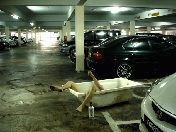 supposedly taking bath in the car park