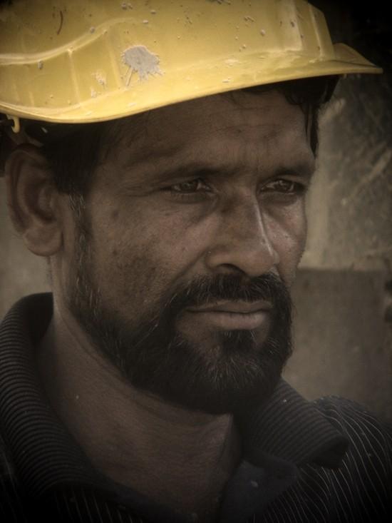 worker taken with binocular in counstruction site